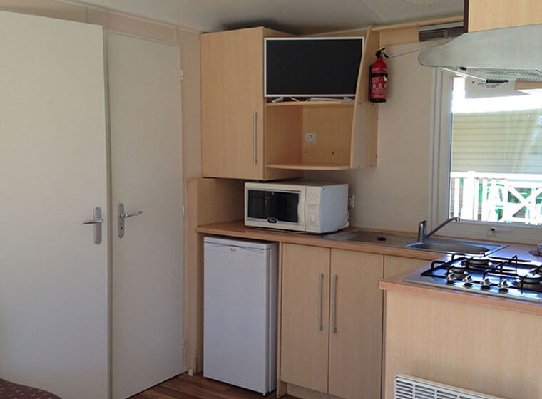 Loggia mobile home kitchen section camping Val d'Amour